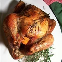 Orange Herb Roasted Chicken Recipe - This whole roasted chicken turns out terrifically flavorful and tender, and the broth left in the bottom is a perfect gravy in itself!