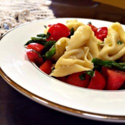 Simple Yet Yummy Tortellini Salad Recipe - This simple tortellini salad is tossed with veggies and dressed with olive oil and salt for a quick and easy, summer side dish.