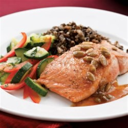 Salmon with Pepita-Lime Butter Recipe - Lime juice, chili powder and pepitas combined with just a bit of butter makes a rich Mexican-flavored sauce for this salmon.