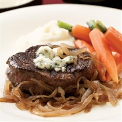 Seared Steaks with Caramelized Onions and Gorgonzola Recipe - Beef tenderloin is naturally lean and mild-flavored, so it's great paired with the intense flavors of sweet caramelized onions and salty Gorgonzola cheese.