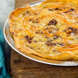 Bacon and Cheddar Cheese Quiche Recipe - This hearty quiche is the perfect brunch dish to bring to your friends' Sunday morning get-together when you bake it in a Reynolds(R) Bakeware Pie Pan.