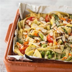 Baked Pasta Primavera Recipe - Bake veggies with creamy sauce and pasta for a yummy summertime dish-and with Reynolds Wrap(R) Pan Lining Paper there's no cleanup!