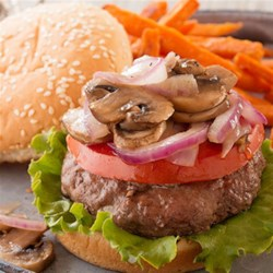 Blue Cheese Stuffed Burgers  Recipe - Sharp, creamy blue cheese wrapped inside juicy burgers and topped with grilled mushrooms and onions make for a perfect summer dinner.