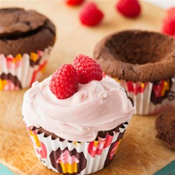 Chocolate Raspberry Cupcakes Recipe - Fill chocolate cupcakes with raspberry preserves for a sweet surprise, and then top with a fresh berry for a nod to what's inside.
