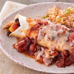 Easy Chicken Enchiladas from Reynolds(R) Recipe - Give this classic Tex-Mex dish a fresh update by adding butternut squash or sweet potato.