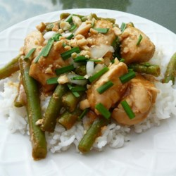 Erin's Indonesian Chicken Recipe - Chicken and green beans are served over rice with a spicy peanut sauce.