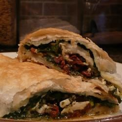 Mediterranean Puff Pastry Chicken Recipe - Cooks who love intensely flavored ingredients of Mediterranean cuisine--garlic, basil, sun-dried tomatoes, feta cheese--will enjoy these savory chicken breasts wrapped with flaky puff pastry.