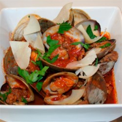 Clams and Sausage in Spicy Marinara with Crostini Recipe - Spicy tomato-basil sauce with sweet littleneck clams, sausage, and fennel are served with toasted crostini rounds make a delicious one-pot meal.