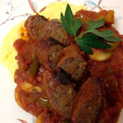Creamy Polenta with Arrabbiata Sausage Ragout Recipe - Creamy polenta with Parmigiano-Reggiano cheese makes a luscious base for sausages simmered in a spicy, robust sauce.