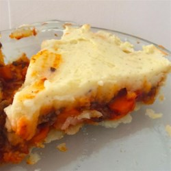 Saucy Shepherd's Pie Recipe - Ground beef, onions, and carrots with tomato-basil sauce topped with mashed potatoes are baked for a delicious and easy comfort-food meal.