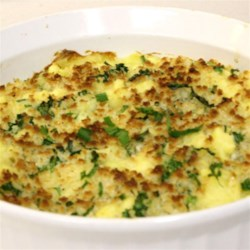 Herbed Alfredo Mashed Potatoes Recipe - Roasted garlic, fresh herbs, and Alfredo sauce make a rich, creamy mashed potato casserole, and the panko topping gives them some crunch.