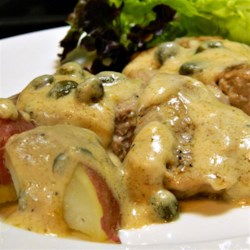 Alfredo Medallions Recipe - Pork tenderloin medallions with Alfredo sauce make an easy but tasty meal and it's ready in less than half an hour!  Serve over freshly boiled red potatoes for a delicious gluten-free meal.