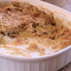 Egg Chicken Casserole Recipe - Eggs and bread add a particular smoothness to this chicken and soup casserole.