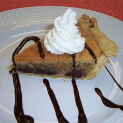 Chocolate Chip Cookie Pie Recipe -  Pretend your making a batch of chocolate chip cookies, but with a bit more butter. Pour into a pie shell instead of plopping onto a cookie sheet, and you 've got this irresistibly sweet pie. Top with caramel and vanilla ice cream.
