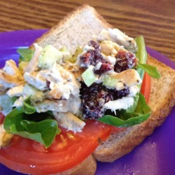 Grilled Chicken Salad Sandwich Recipe - Whether you use leftover chicken from an earlier meal, or you make the chicken specifically for this dish, you'll be pleased with the combination of celery, dried cranberries, cashews, spices, and mayonnaise for a quick and delicious sandwich option.