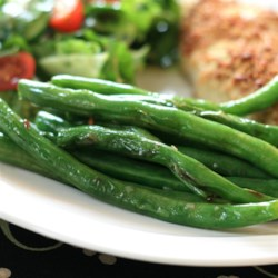 Grilled Green Beans Recipe - Green beans, simply seasoned with kosher salt and minced garlic, make an incredibly easy grilled side dish.
