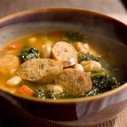 Spanish Style White Bean and Sausage Soup Recipe - Andouille sausage and kale are great additions to this white bean soup. This soups flavor is blended perfectly. It is a real taste bud pleaser.