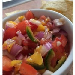 Spicy Sweet Salsa Recipe - A perfect balance of sweet and spicy in this easy homemade mango salsa packed with fresh ingredients will have you coming back for more.
