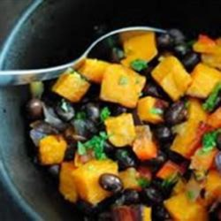Sweet Potato and Black Bean Salad Recipe - This sweet potato salad features the southwestern flavors of jalapeno, garlic, and lime making it great side to any Mexican meal.
