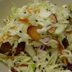 Ramen Coleslaw Recipe and Video - This is a very crunchy, very satisfying coleslaw with ramen noodles, cabbage, toasted almonds and sesame seeds. The dressing is vinegar and oil with lots of herbs and a tad of sugar.