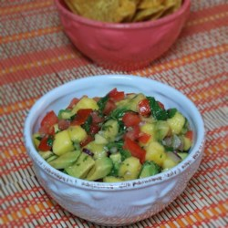 Refreshing Avocado, Tomato, and Mango Salsa Recipe - You get a refreshing combination of sweet, savory, and spicy all in one salsa recipe combining tomato, mango, avocado, and jalapeno pepper.