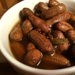 Rachael's Superheated Cajun Boiled Peanuts Recipe - Raw peanuts in their shells simmer in a salty, spicy brew flavored with crab boil, Cajun seasoning, garlic, and two kinds of serious hot peppers. This is the real deal that is found in the heart of Florida.