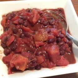 Easy Black Beans and Tomatoes Recipe - This mixture of black beans and tomatoes is seasoned with lime juice, garlic, cumin, and chili powder to make a great sauce for fish tacos.