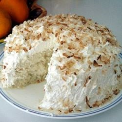 Coconut Cake I Recipe - This cake starts with a white cake mix and ends up with four layers with a yummy coconut filling.