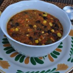 Black Bean Vegetable Soup Recipe - Black bean vegetable soup with pureed tomatoes and corn is a hearty and warm dish to serve on cold days.
