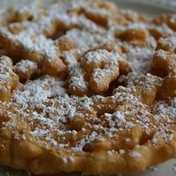 Funnel Cakes IV Recipe and Video - This recipe for homemade funnel cakes brings the deep-fried carnival treat home to you!