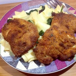 Quick Crispy Parmesan Chicken Breasts Recipe - This quick and easy recipe for crispy Parmesan chicken breasts goes well with pasta, on a salad, or even on its own.