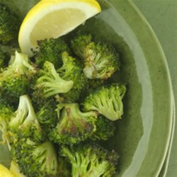 Roasted Broccoli with Lemon Recipe - Roasting broccoli concentrates the flavors and caramelizes the natural sugars. A touch of olive oil gives it a crispy, delicious finish.