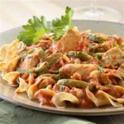 Sofia's Chicken Paprikash Recipe - Brilliant red paprika, the main seasoning in Hungarian cooking, gives this light version of chicken paprikash its color. Vary the heat by using hot, sweet or a combination of paprikas.