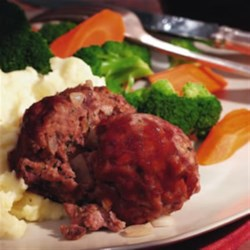 Mini Meatloaves Recipe - Traditional meatloaf is made with ground beef, pork and veal; here we replace the veal with ground turkey for a tender, flavorful and leaner version of the classic.