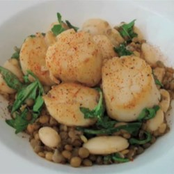 Scallops with Arugula, Lentils, and Butter Beans  Recipe - This very delicious scallops with arugula, lentils, and butter beans recipe is a savory spring dish.