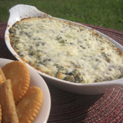 Hot Asiago and Spinach Dip Recipe - This cheesy and creamy hot dip is perfect for entertaining and can also be served as an appetizer. Serve with pita bread, baguette, tortilla chips, or veggies.