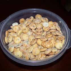 Seasoned Crackers Recipe - Serve these oyster crackers seasoned with dill weed, garlic powder and packaged ranch dressing as a snack, or as a garnish for soup or chowder.