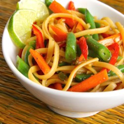 Spicy Sesame Noodle Salad Recipe - A bright, colorful salad with linguini, carrots, green onions, and lightly cooked green beans gets an Asian taste from orange zest, toasted sesame oil and soy sauce, and a hint of heat from chopped serrano peppers.