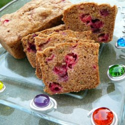 Citrus Cranberry Zucchini Bread Recipe - Zucchini bread, with a hint of lemon and orange, and accented by dried cranberries, is a delicious twist on a summer classic.