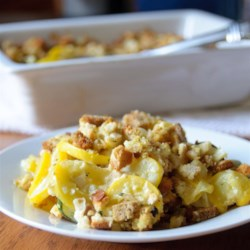 Squash Casserole II Recipe - this casserole is creamy with a wonderful herbed topping. You can also mix leftover turkey or pork in this dish and serve as a main dish after the holidays.