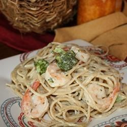 Angel Hair Pasta with Garlic Shrimp and Broccoli Recipe - Angel hair pasta is tossed with sauteed shrimp and steamed broccoli, and topped with a rich garlicky cream sauce.