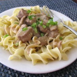 Slow Cooker Beef Stroganoff I Recipe - Beef, condensed golden mushroom soup, chopped onion, and Worcestershire sauce simmer in a slow cooker for easy beef stroganoff.