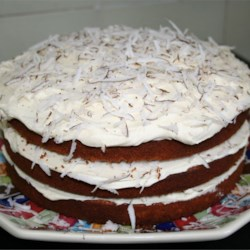 Fresh Coconut Cake Recipe - This delicious cake is made with fresh coconut. Three moist cake layers are topped with a fluffy coconut buttercream frosting.