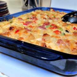 Cheesy Amish Breakfast Casserole Recipe - This hearty casserole has bacon, eggs, hash browns, and three different cheeses all baked into a comforting breakfast dish, perfect for feeding a crowd.