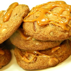 Caramel Pecan Cinnamon Roll Cookies Recipe - All the flavors of a cinnamon roll with pecans are together in this cinnamon roll cookie recipe. Drizzle caramel over each cookie!