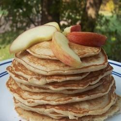 Apple Yogurt Pancakes Recipe - Plain yogurt, shredded apples and cinnamon grace these pancakes.