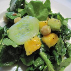 Summer Kale, Avocado, Mango, and Chickpea Salad with Citrus Poppy Seed Vinaigrette Recipe - Kale, avocado, mango, and chickpeas are topped with a citrus poppy seed vinaigrette in this recipe for a delicious summertime salad!