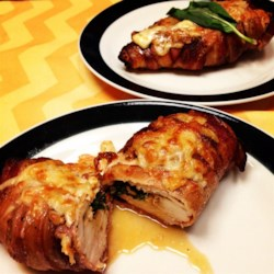Stuffed Tomato Basil Chicken Recipe - Garlic and herb marinated chicken breasts are stuffed with basil, tomato, and provolone; wrapped with bacon, and baked in the oven.