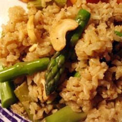 Asparagus Cashew Rice Pilaf Recipe - Toasted cashews and tender asparagus are mixed with seasoned jasmine rice and cooked pasta.