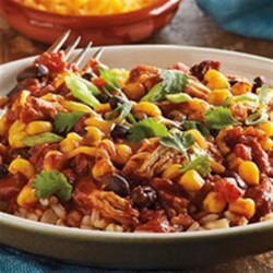 Slow Cooker Mexican Chili Bowls from Del Monte(R) Recipe - Taco seasoning, green chilies, and a hint of chocolate and peanuts give this Mexican-inspired, slow cooked chicken rich flavor.